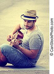 גיטרה, משחק, איש