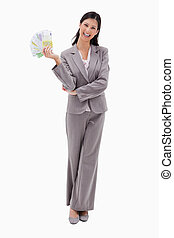 לחייך, כסף, אישת עסקים